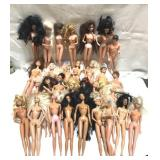 Lot of Barbie and Ken dolls including a Donnie