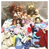 Lot of vintage dolls and doll clothes