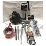 A lot of tools and other items including paint