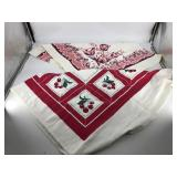 Two vintage tablecloths– the cherry one is