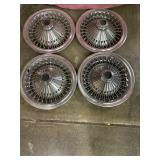 set of chrome hubcaps, looks like they have