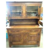 Wooden shelf and top cabinet with glass doors,