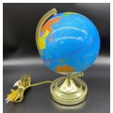 Light up spinning plastic globe, it does work