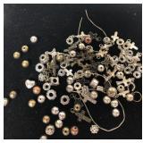 Pieces of charm bracelets