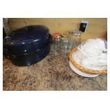 Roasting pan, paper plates, Mason jars.