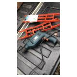 Black an decker power tool and ext.cord wrap