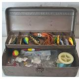 Small brown metal tackle box with lures and more