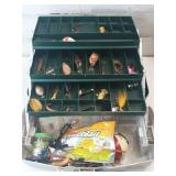 Green and white plano tackle box with lures and