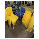 lot of approx 25 yellow/blue plastic kids chairs