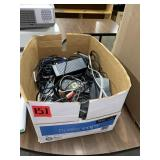 Box lot of cords, remotes, chargers