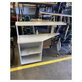small desk, shelving unit