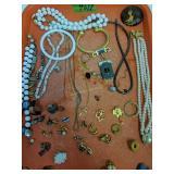 Tray Lot Costume Jewelry. 1 Light Chain Marked 14k