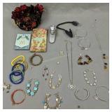 Costume Jewelry, Notepads, Book Lights Etc