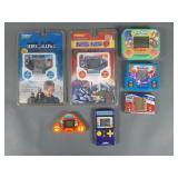 7pc Vtg Hand Held Electronic Games w/ Mega Man