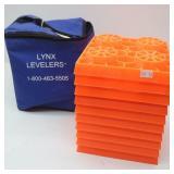 Orange LYNX LEVELERS in Zippered Storage Bag