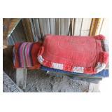 Stack of Saddle Blankets & Saddle Stand