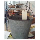 old metal bucket w metal contents
