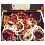 box case of costume jewelry necklaces bracelets