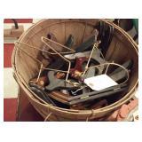 old harvest basket full of picture stands