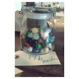 Lidded jar with old marbles