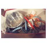 box of leashes and feed bowls, most w orig tags