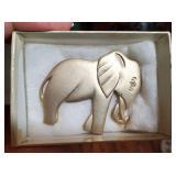 Gold tone elephant brooch w faux diamond eye