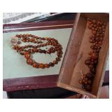 Large lot of unique old orange / black beads