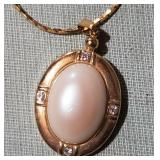 Beautiful gold tone elegant necklace faux diamonds
