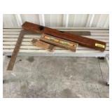 Framing square, vintage wooden Stanley level, Crick level and vintage folding ruler