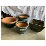 Four ceramic outdoor planters
