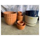 Quantity of terra-cotta plants and two plastic indoor planters