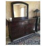 """Ashley Furniture 7 drawer dresser with mirror. Measures 65 x 17 x 40 Mirror adds an add'l 36"""" and removes for moving No other items included"""
