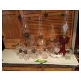 Kerosene lanterns of all shapes and sizes, one electric lantern