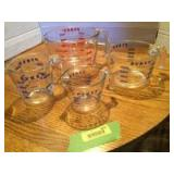 Four Pyrex measuring cups-1c, 2c, 4c and 8 cup