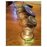 Five glass Pyrex bowls with 4 vent lids