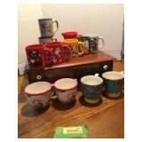 Twelve coffee mugs-Pioneer Woman, Louisville Stoneware, Waechtersbach W. Germany and one illegible mark