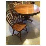 """Oak dining room table w two leaves and 4 chairs Measures 63"""" L x 45"""" W x 31"""" H (measurements include extra two leaves). Each leaf measures 9"""" W x 45"""""""
