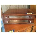 "Two drawer walnut spool cabinet. Measures 18"" L x 15"" W x 6"" H."