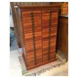 """50 drawer dental-style cabinet. Measures 24"""" L x 39"""" H x 18"""" W. Small lamp included. Oak??"""