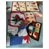 Three 32 x 46 area rugs, 3 entryway mats and two seasonal outdoor flags
