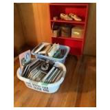 24 x 10 x 43 wooden red shelf on retro style legs, wooden shoes - literally. Baskets, recipe box, 2 laundry baskets full of books