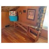 71 x 9 x 19 pine bench with wooden cross brace, storage baskets, 17 x 21 framed art, plus other art on the wall, shelf bench