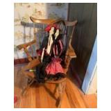 Smaller hard rock maple rocking chair occupied by Mr. and Mrs. Dracula