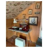 Viking Husqvarna sewing machine from Sweden model # 64 60 and sewing table with lamp measuring 42 x 20, artwork on the wall behind the sewing machine, sewing machine picture tile