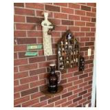 Wall decor includes Gutman collector plates, wall shelves, Granite City growler, house shaped shadow box with blue and white tchotchkes, thimble collection and an angel