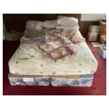 Queen size mattress w split twin box spring and linens-includes three newer down pillows by Eddie Bauer and Living Quarters