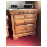 Modern two drawer nightstand with two clock radios