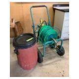 Rain barrel and garden hose on hand crank utility cart