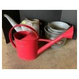 Galvanized buckets, radiator can and a pretty red watering can
