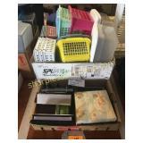Plastic baskets, photo albums